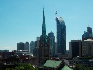From John`s condo, the southerly Toronto skyline beyond St. James Cathedral portrays urban beauty at its finest in this booming metropolis.