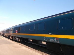 One of the 24 cars on The Ocean headed to Halifax shines in the brilliant sunlight at Campbellton New Brunswick.