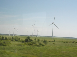 In the flat breezy marshes near Sackville New Brunswick and Amherst Nova Scotia,  wind turbines are generating energy.