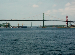 Halifax is a very deep, long harbour and is a thriving industrial port.  The MacDonald Bridge in teh foreground, and the Mackay Bridge in the distance link Halifax with its twin city, Dartmouth, on the opposite shore.
