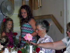 Olivia (centre) and her sister Rachel help their great-grandmother blow out the candles on her cake.  Olivia is an award-winning young soprano and Rachel loves to dance!