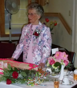 Vivian acknowledges the assembled guests at her 90th birthday party before the cake is cut and enjoyed by all.