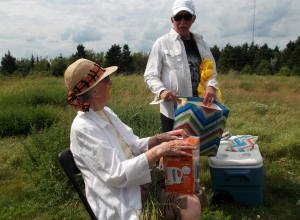 Dwight assists his mother Vivian with some gifts that she received at the old farmhouse site where she was born.