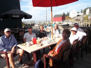 In the slanting rays of lovely afternoon at Hall's Harbour, my aunt, several cousins and spouses and I relax after our big seafood dinners.
