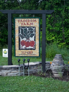 This beautiful mosiac sign welcomes clients and guests to the Freedom Farm property, which included the Three Little Cottages.