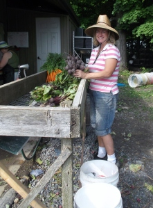 Sharon proudly holds up some beautiful beets - a Freedom Farm specialty.