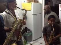 Luther 'jams' with a young Dominican music friend in his wife Ruth's  kitchen in Dominica!