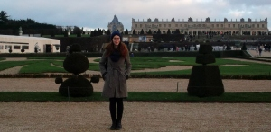 Carole poses with the stately Palais Versailles behind her.