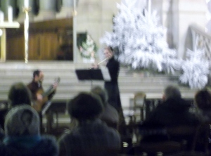 The guitarist and flautist who performed at the free midday concert at Trinity Church sounded heavenly.  They also looked angelic in the dim light, as captured by my camera.