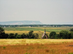 Distant Cape Blomidon,verdant fields and the historic Grand Pre church with its dramatic Acadian history are prominent features in Nova Scotia's Annapolis Valley.