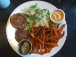 An east coast meal at the Bluenose Cafe in Halifax: codfish cakes, sweet potato fries, Caesar salad and condiments.